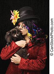 Woman with Pomeranian dog.
