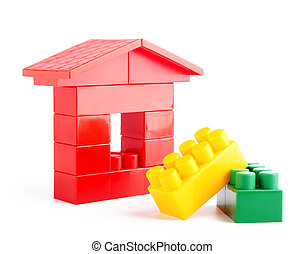 Toys blocks. - The house construction by lego blocks.