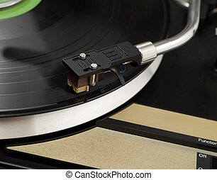 Record Player - Closeup of a record player, playing music