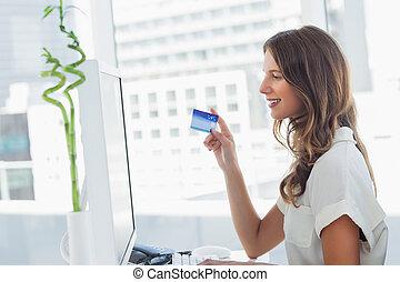 Cheerful designer purchasing online
