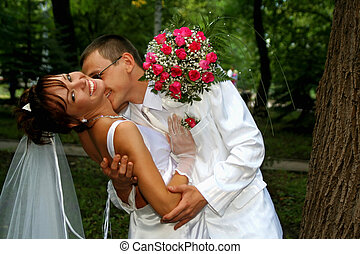Groom kissing bride - Photo of the groom and bride kiss