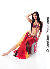 Beautiful Belly Dancer in a Red Costume - Beautiful brunette...