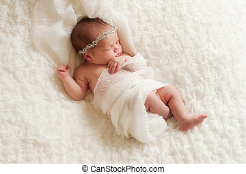 Portrait of an Angelic Newborn Girl - An overhead view of a...