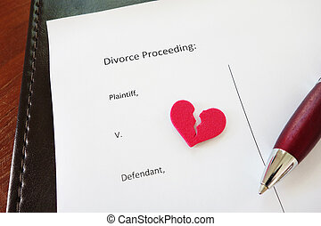 red heart - Divorce document with broken red heart and pen...