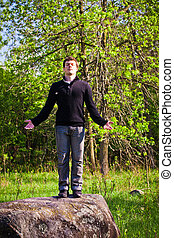 Man standing up on the rock
