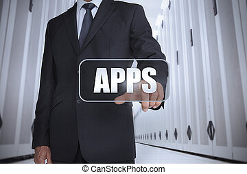 Businessman in a data center selecting label with apps...