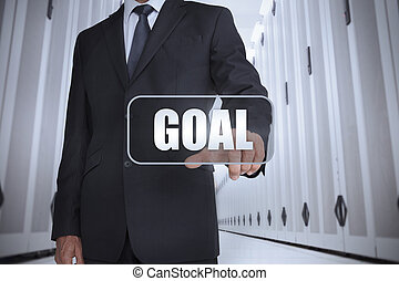 Businessman in a data center selecting label with goal...
