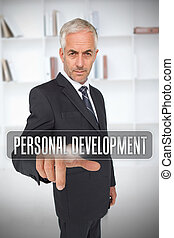 Businessman touching the term personal development in front...