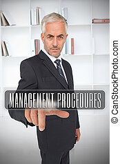 Businessman selecting the term management procedures in...