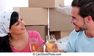 Couple celebrating a move