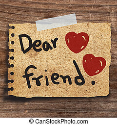 paper - Text dear friend and red heart on short note vintage...