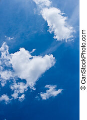 heart-shaped cloud with blue sky