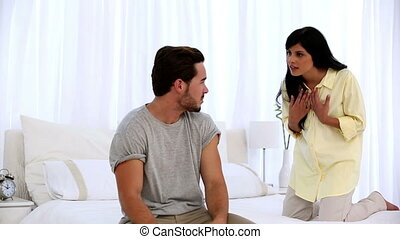 Couple arguing in the bedroom - Young couple arguing in the...