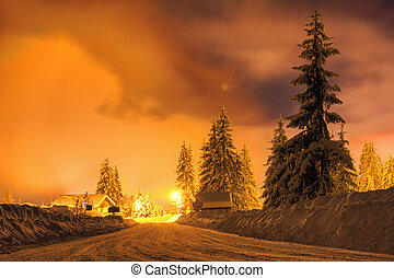Snowy road - Night scene with snow on the road in the light...
