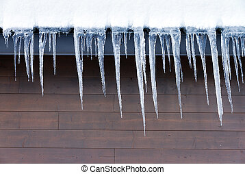 Icicles hanging from the gutter in winter