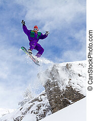 Snowboard cliff jump - Awesome snowboarder jumps of a cliff...