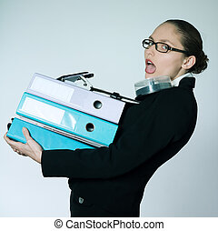 business woman carrying files and folders