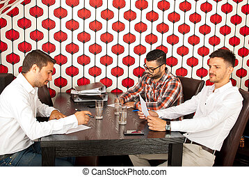Meeting of three business men - Business men having a...