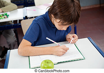 Schoolboy Copying From Cheat Sheet During Examination - High...