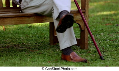 Retired man relaxing on a bench