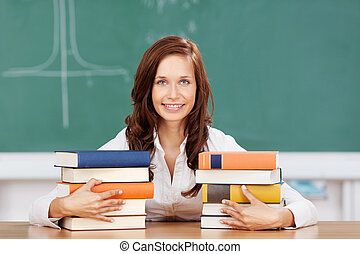 Smiling student with her textbooks - Smiling attractive...