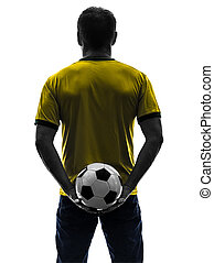 rear view back man holding soccer football silhouette - one...