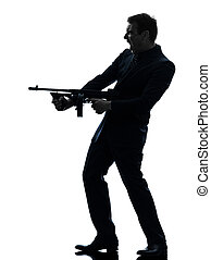 gangster man holding thompson machine gun silhouette