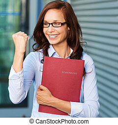 Excited businesswoman - Excited young business woman with...