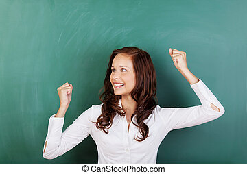 Successful student rejoicing at passing her grades standing...
