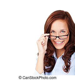 Happy woman peering over her glasses - Happy attractive...