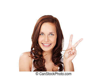 Peace sign - Beautiful brunette woman showing her peace sign