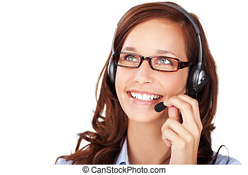 Friendly smiling woman wearing a headset and glasses as she...