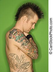 Shirtless male with tattoos. - Profile of Caucasian man with...