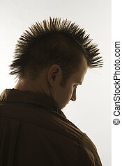 Caucasian man with mohawk. - Profile of Caucasian man with...