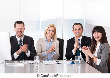 Happy Business People Clapping - Happy Group Of Business...