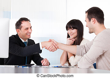 Consultant Shaking Hands With A Man In Office