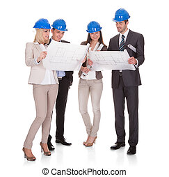 Group Of Architect Discussing Project Over White Background