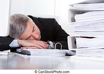 Mature Businessman Sleeping At Desk - Tired Mature...
