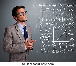 Handsome school boy thinking about complex mathematical...
