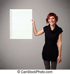 Young woman holding white paper copy space with diagonal...