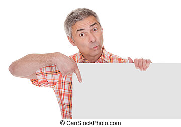 Happy Mature Man Holding Blank Placard Over White Background