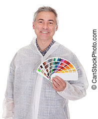 Mature Man With Protective Workwear Holding Color Swatch...