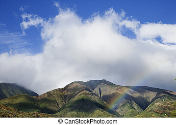 Maui mountains with rainbow.