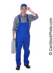 Mature Male Technician Holding Worktool Over White...