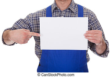 Mature Male Technician Holding Empty Sheet Over White...