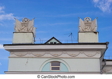 Soviet era sculptures on top the railway station building in...