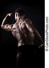 Muscular bodybuilder - Rear view of muscular bodybuilder...