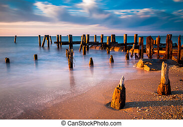 Long exposure at sunset of pier pilings in the Delaware Bay...