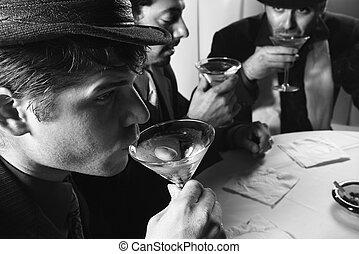 Retro men drinking. - Three Caucasian prime adult males in...