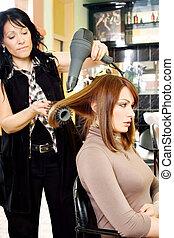 dries hair in salon